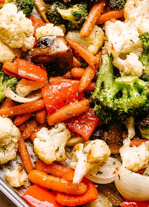 Roasted broccoli, cauliflower, bell peppers, carrots, and mushrooms.