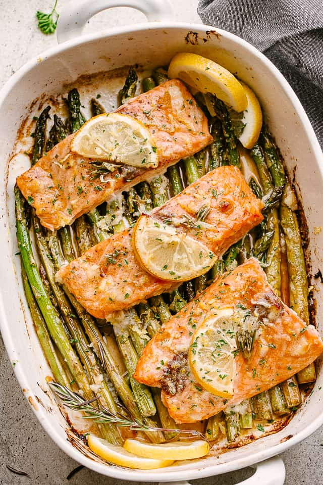 Baked salmon and asparagus in a baking dish.