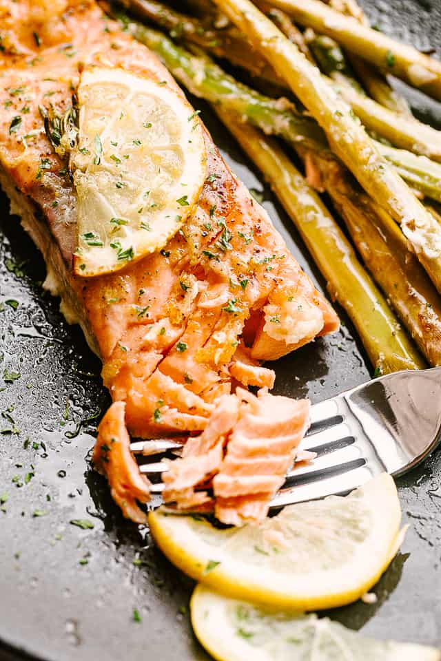 Flaking salmon with a fork.
