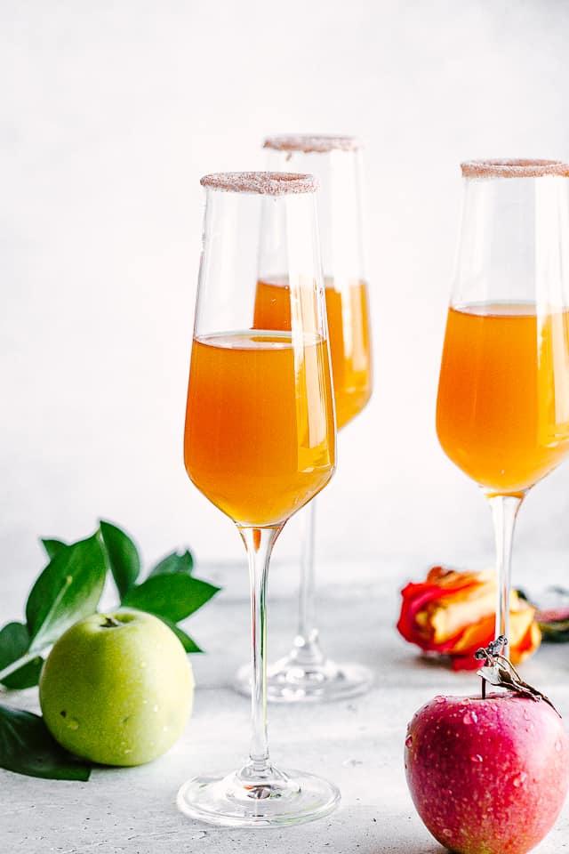 Apple Cider in champagne glasses.