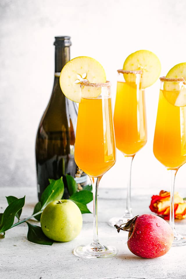 Prosecco bottle with Mimosa cocktails.