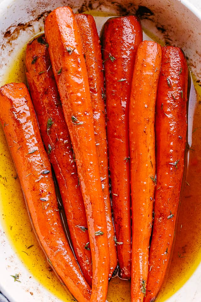 maple roasted carrots in a white serving plate.