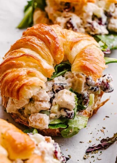 Turkey salad served with a croissant.