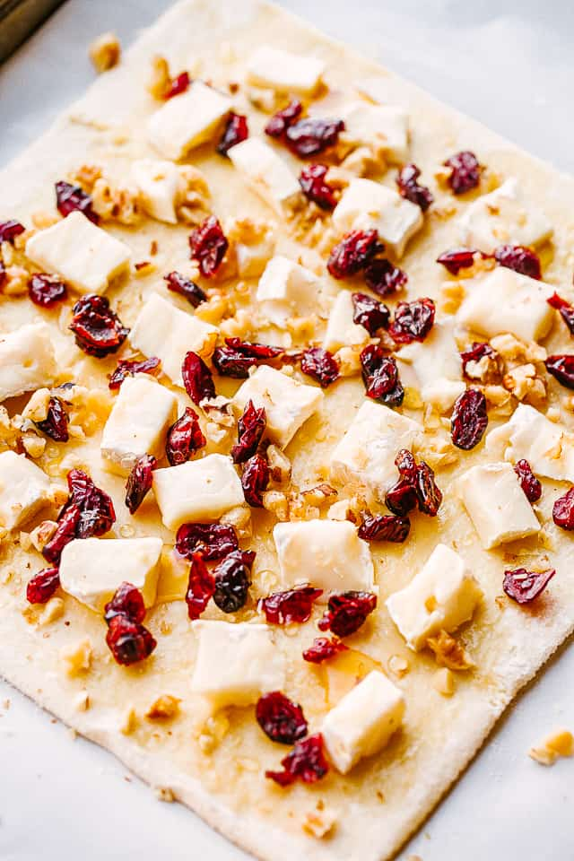 cranberry and cheese spread over raw puff pastry