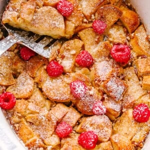 french toast topped with raspberries and powdered sugar
