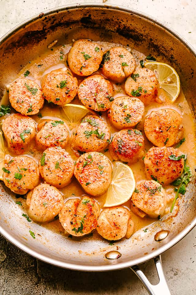 scallops cooked in a skillet with garlic, butter, and lemon juice