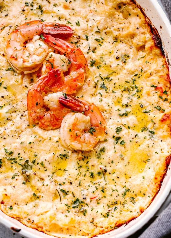 baked shrimp dip topped with cooked shrimp