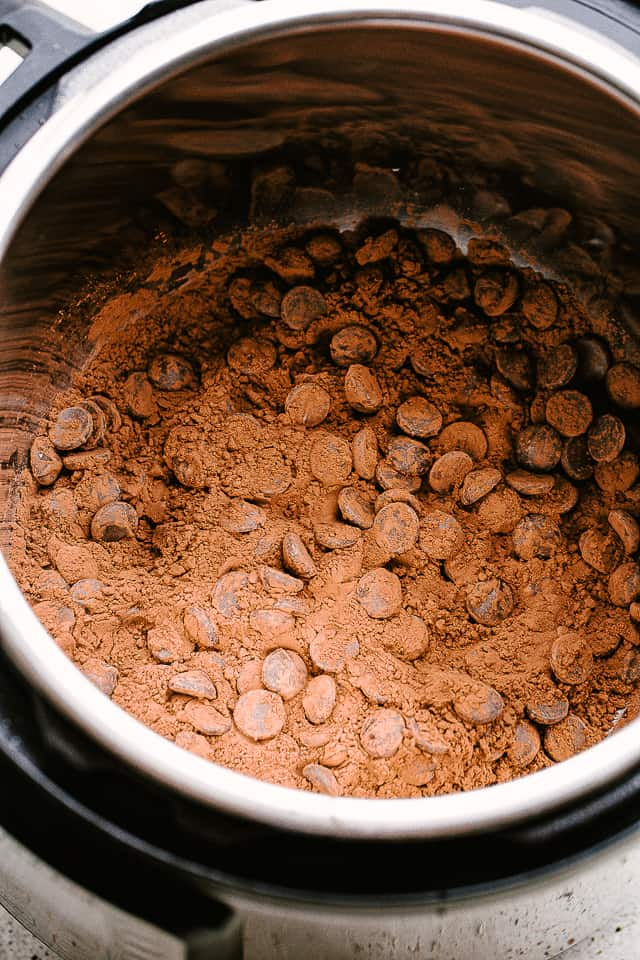 chocolate chips and cocoa powder in the slow cooker