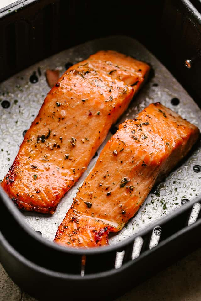 salmon fillets inside an air fryer basket