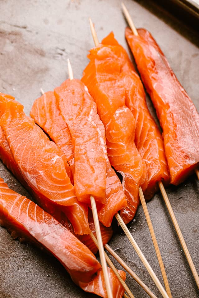 Wooden skewers with salmon