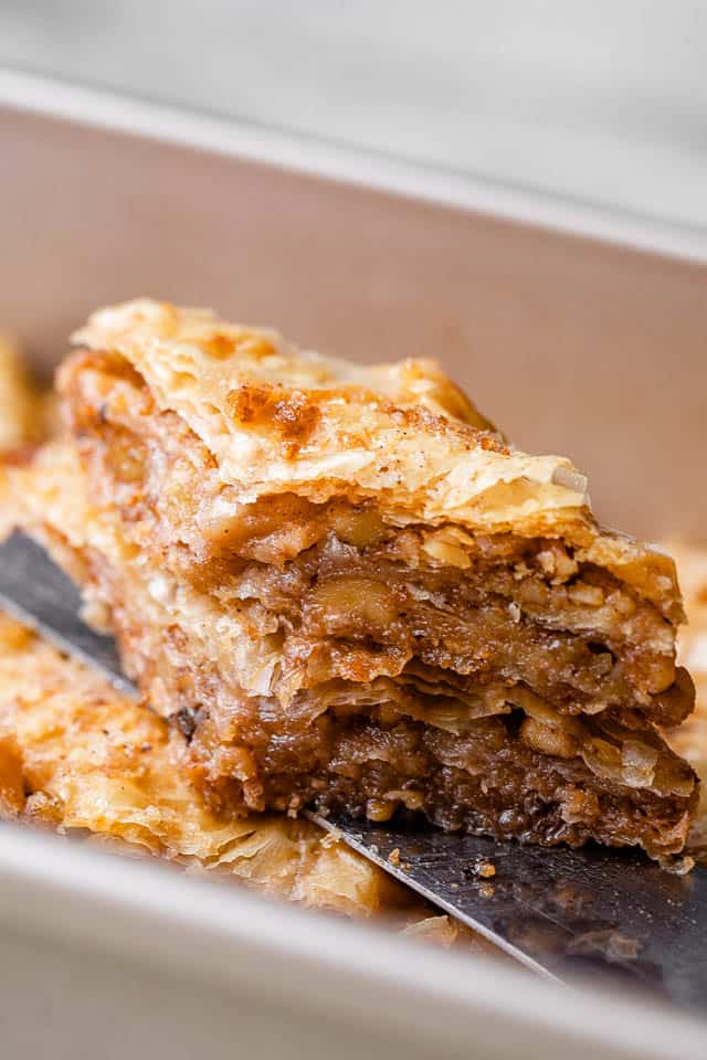 A slice of Baklava being served.