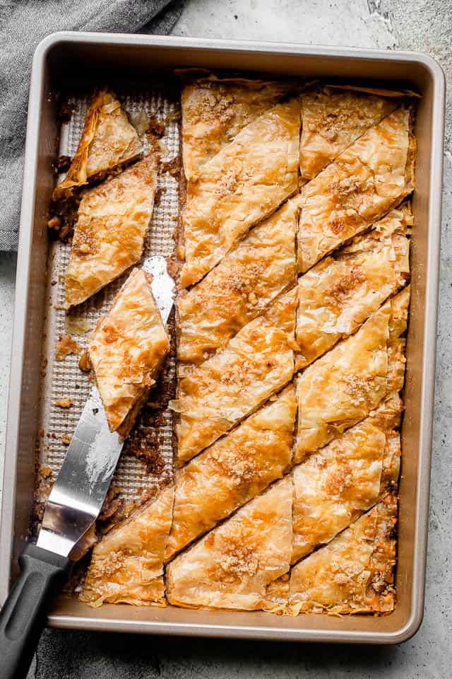 cut up baklava in a pan