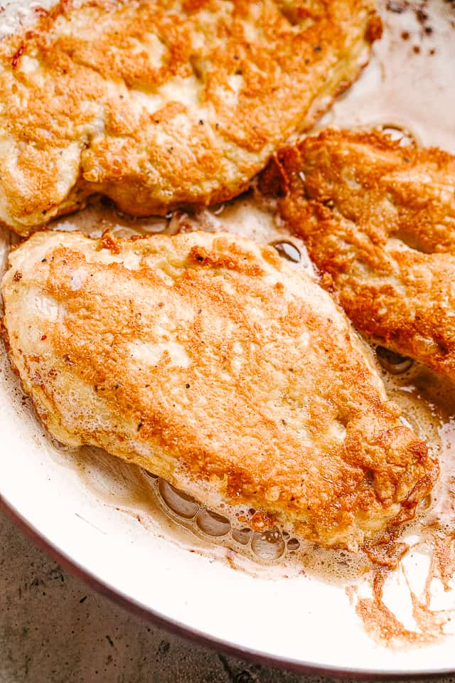 Lightly breaded chicken pan fried