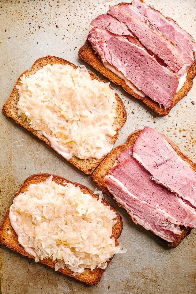 layer corned beef and sauerkraut on rye bread