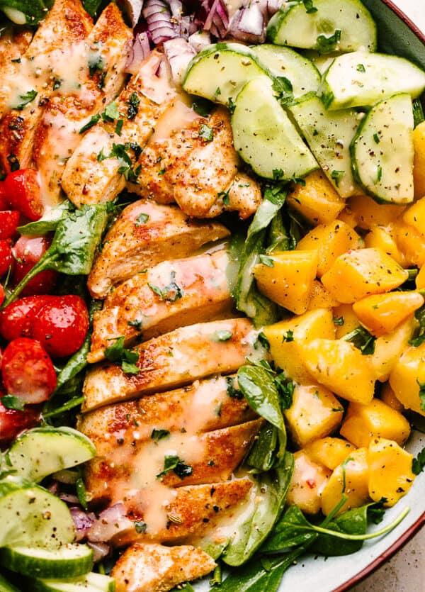 close up of chicken mango salad