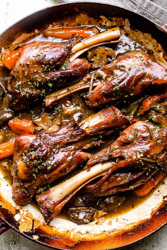 cooked lamb shanks in a pan