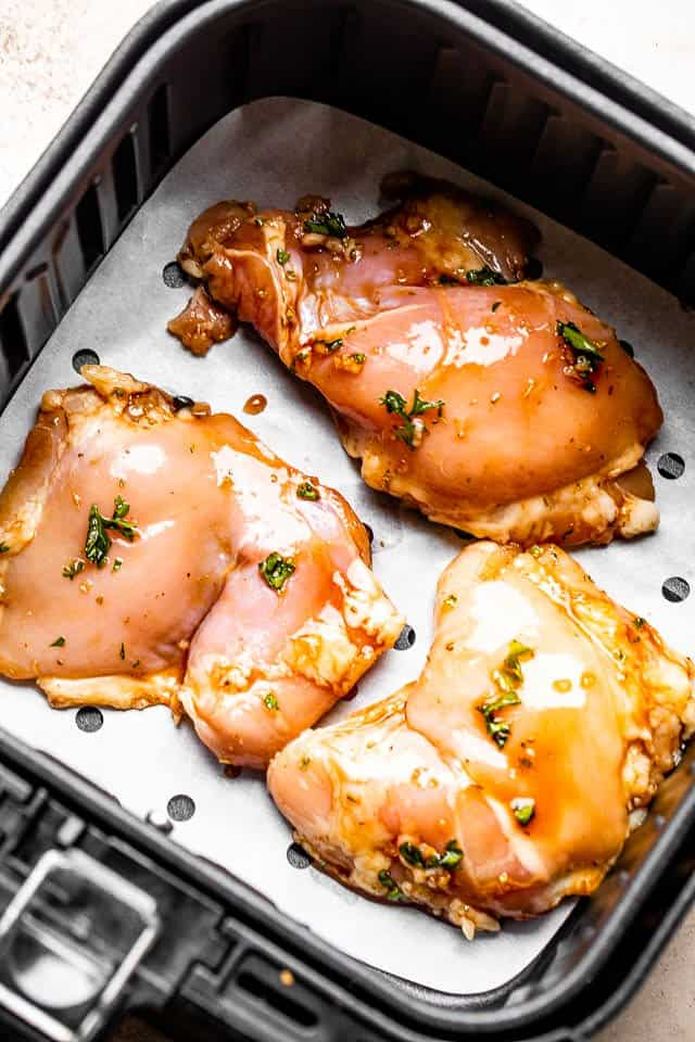 raw chicken thighs in an air fryer
