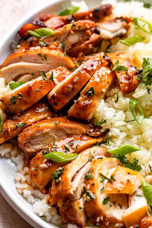 cut up cooked chicken thighs served over rice