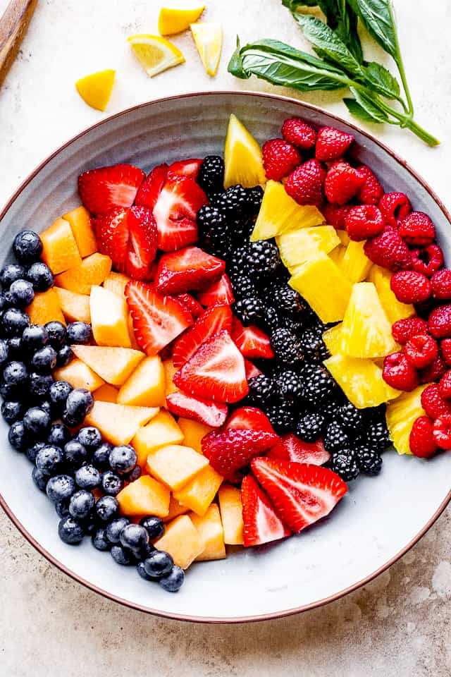 Bowl with blueberries, melon, strawberries, blackberries, pineapple and raspberries