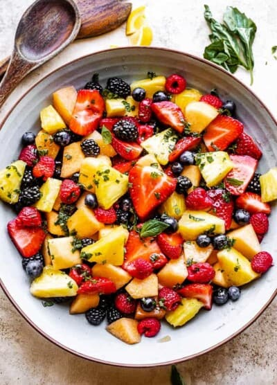 Top view of a mixed berry fruit salad with melon and pineapple