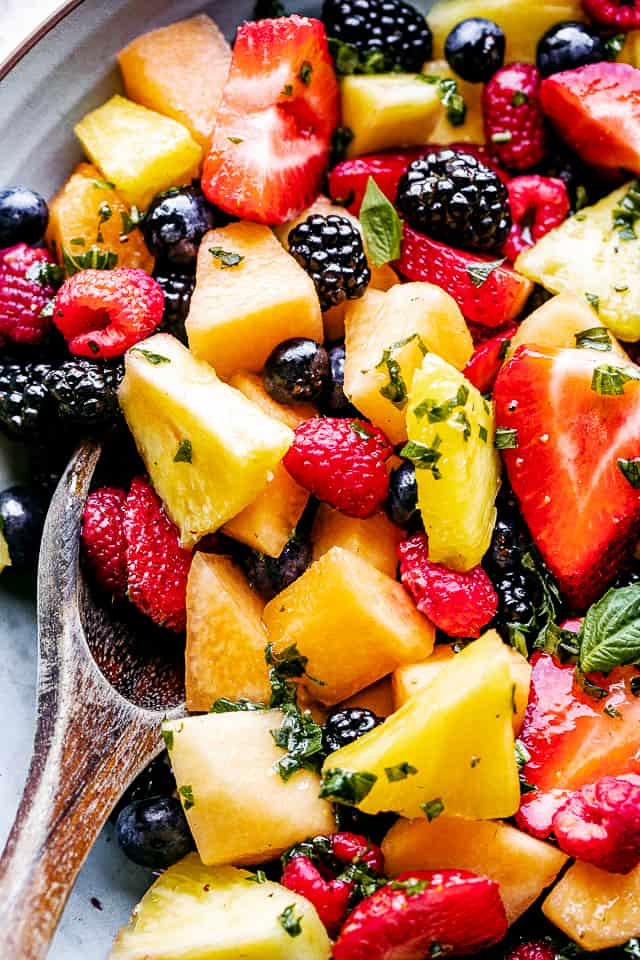 Close up photo of pineapple melon berry fruit salad