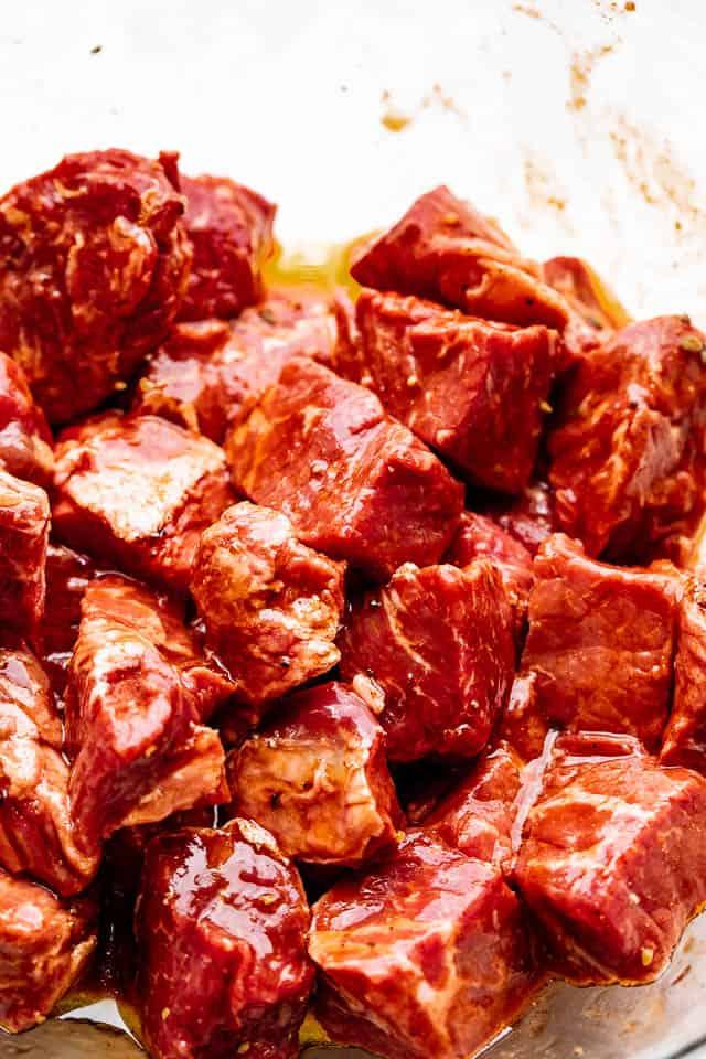 raw steak cut up in cubes