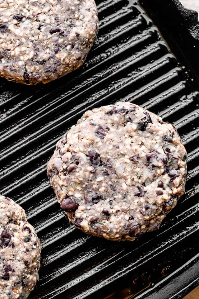 cooking veggie burgers on a grill pan