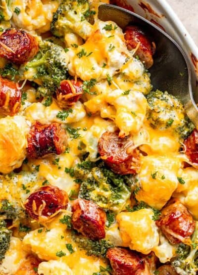 close up view of cauliflower broccoli casserole with sliced smoke sausages and cheese