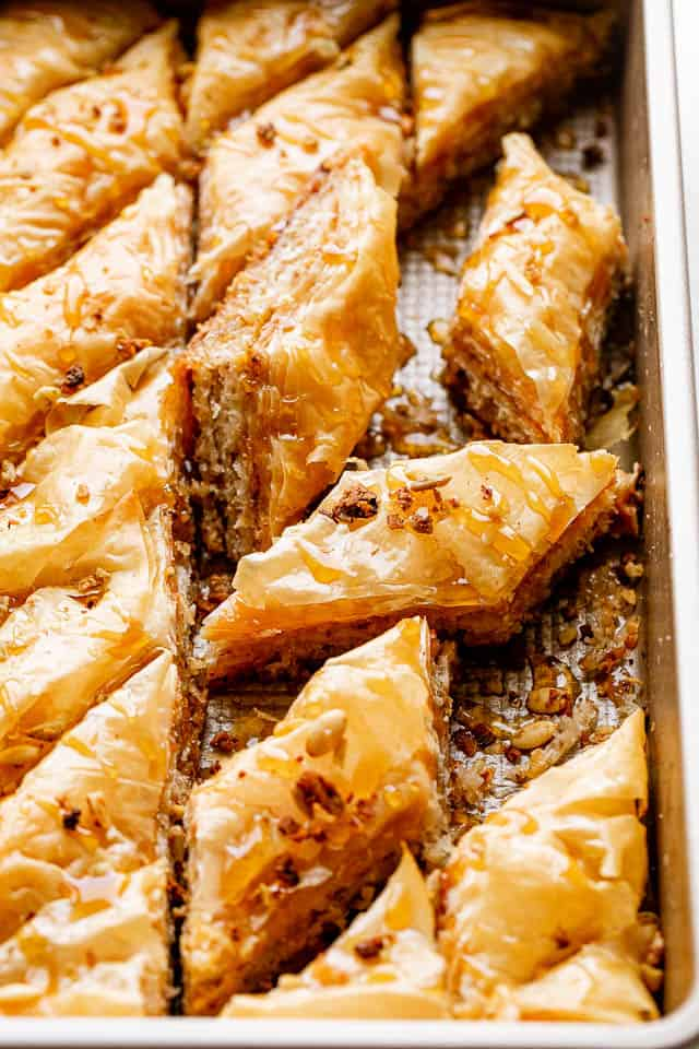 side view of cut up baklava in a baking pan