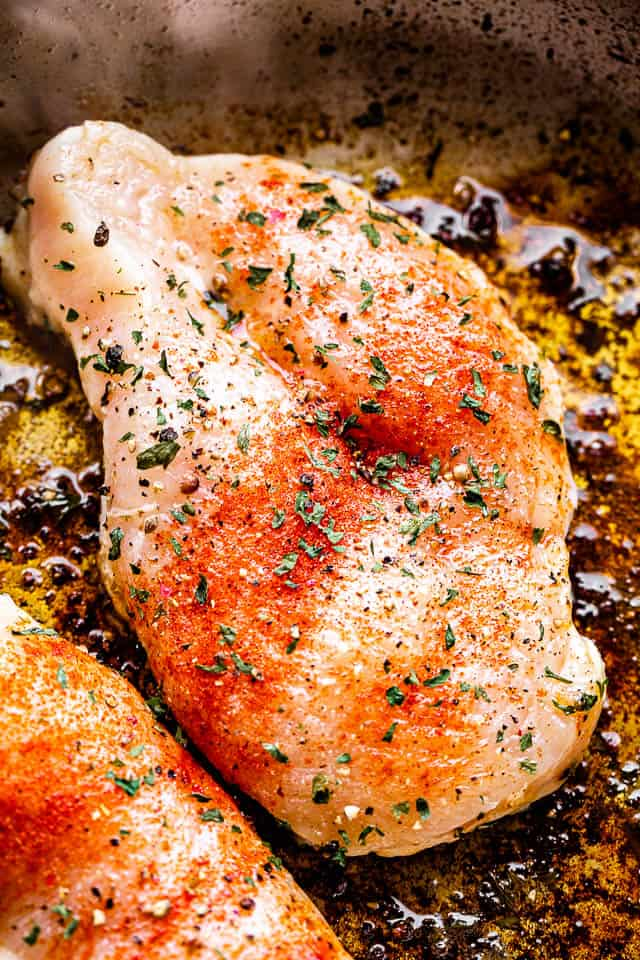 searing chicken breasts in a skillet