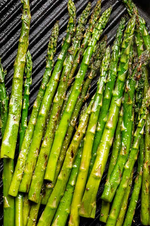 asparagus stalks set on black grill grates