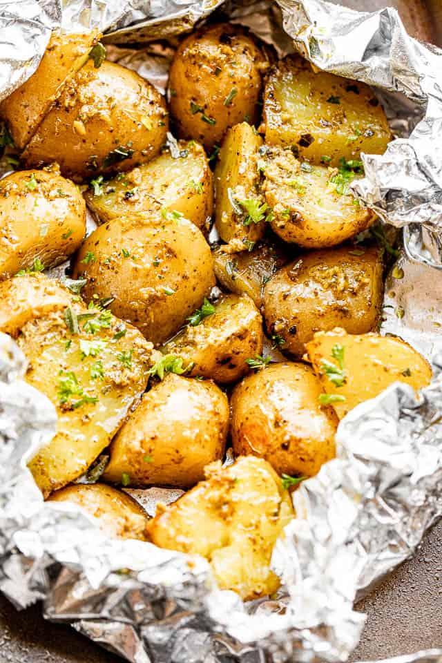 pesto tossed potatoes in foil packs