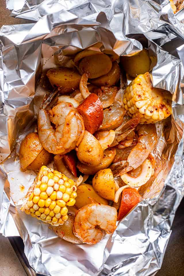sausages, corn, and shrimp arranged in a foil packet
