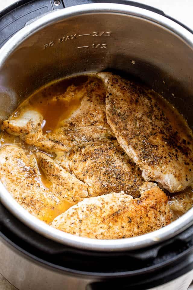 seasoned chicken breasts inside the Instant Pot