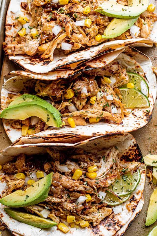 top view shot of 3 chicken carnitas tacos