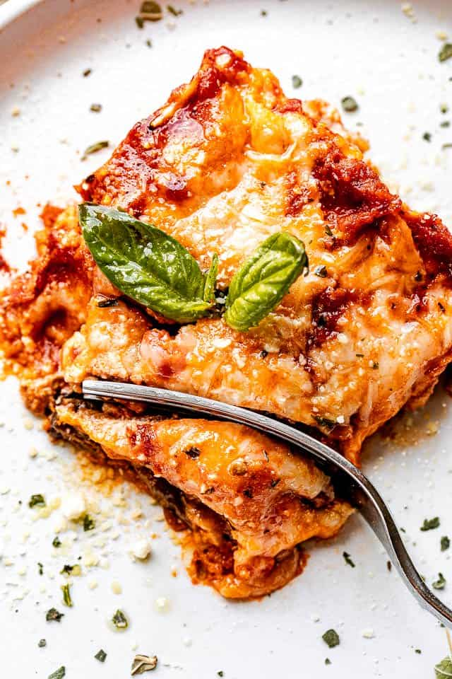 top view of a slice of eggplant lasagna with a fork through it