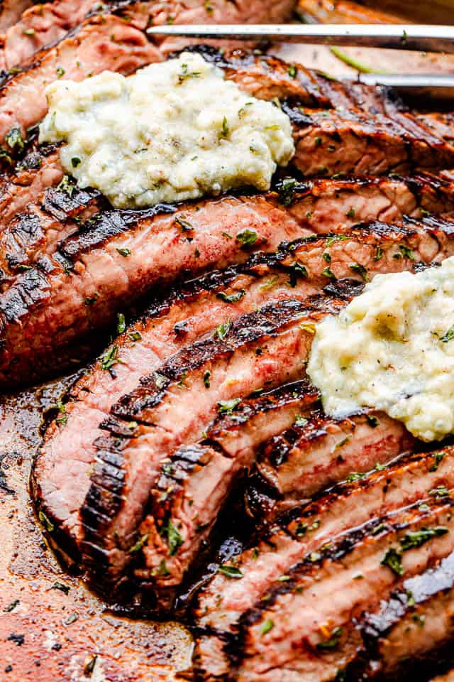 Sliced flank steak topped with butter