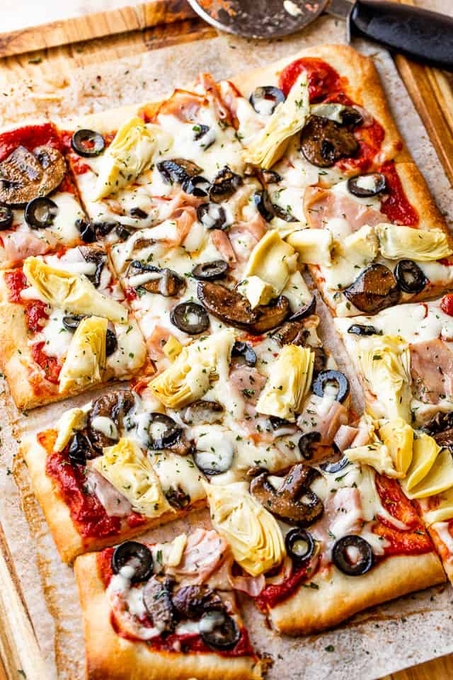 Grilled Pizza Capricciosa cut into squares