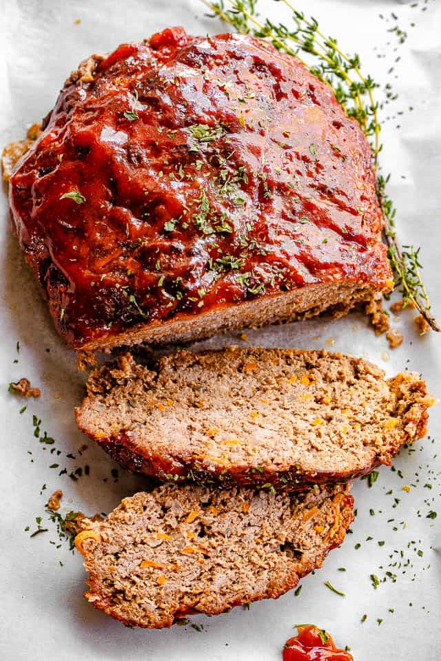 Top shot of meatloaf with ketchup sauce and dried parsley