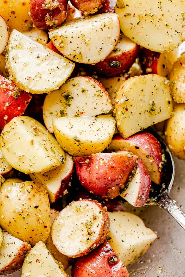 raw red baby potatoes cut in quarters and seasoned