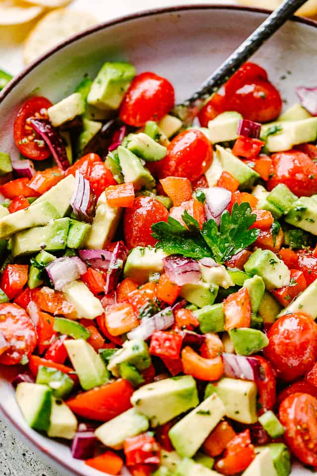 diced tomatoes and avocados in a gray bowl