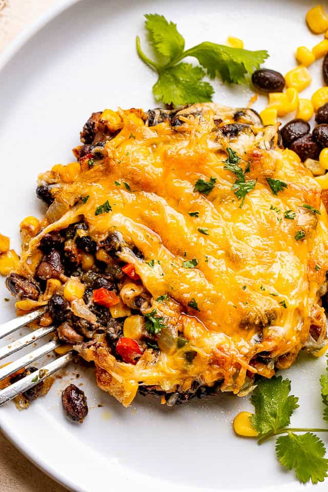 Mushrooms stuffed with black beans, corn, and topped with melted cheddar cheese