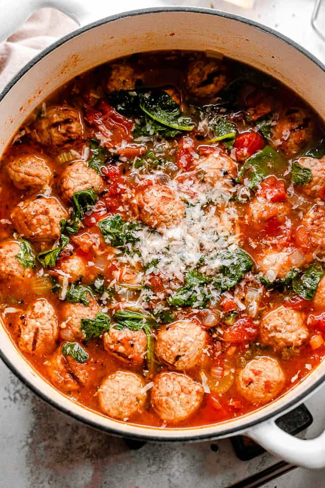 meatballs and kale in a tomato broth