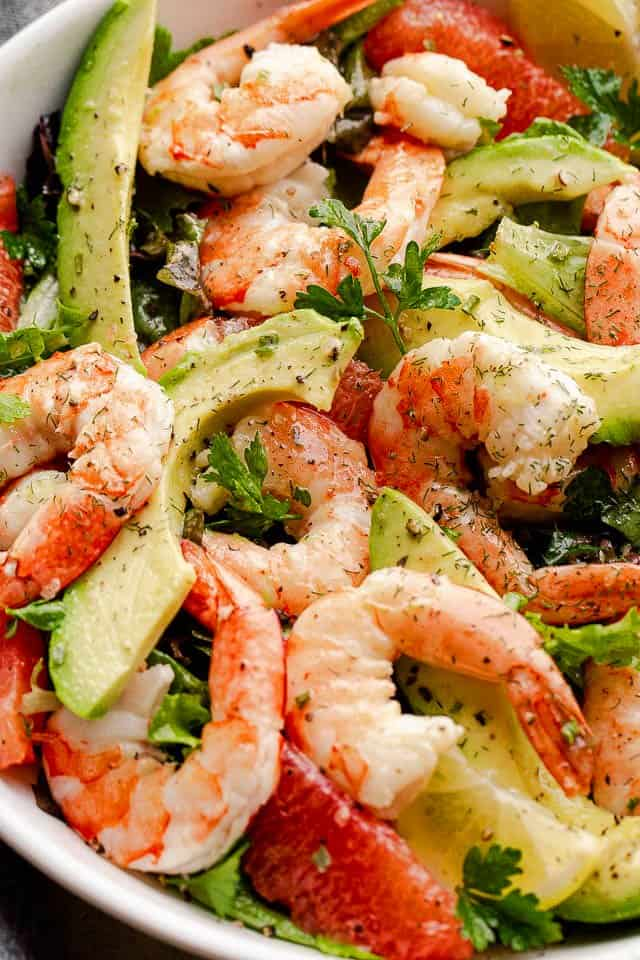 Prawns and avocados in a white salad bowl