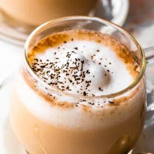 side close up shot of london fog tea latte in glass mug