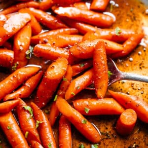close up shot of roasted carrots in cajun butter sauce