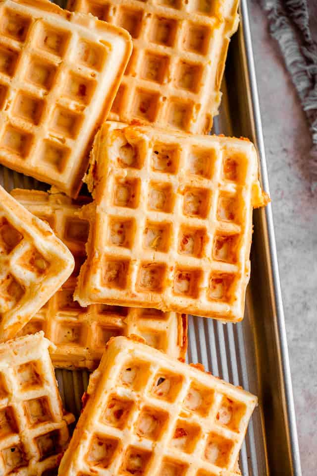 overhead shot of low carb waffles (chaffles) laid out on a silver baking sheet