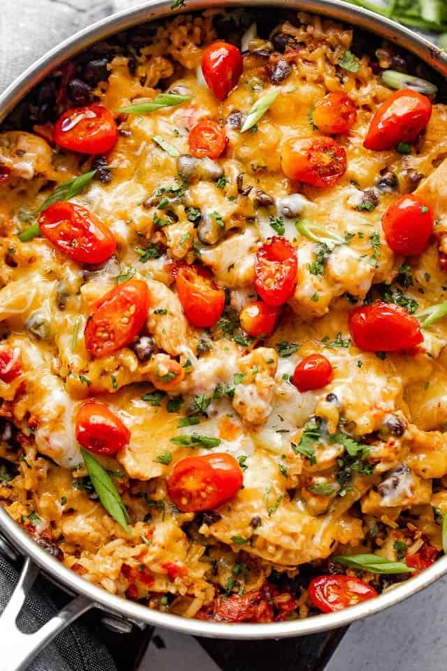 Overhead shot of chicken burrito casserole in a skillet