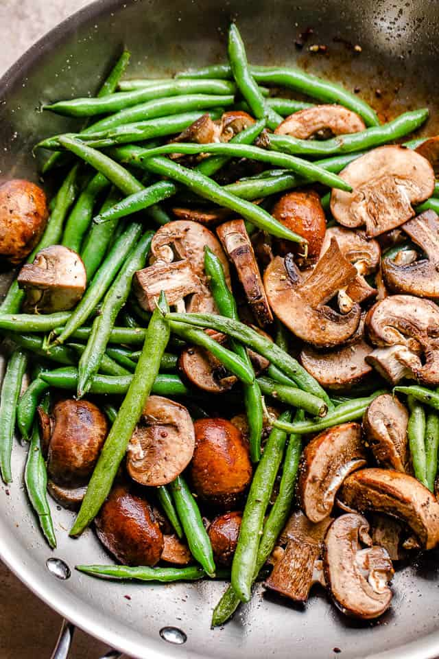 overhead shot of green beans and sliced mushrooms