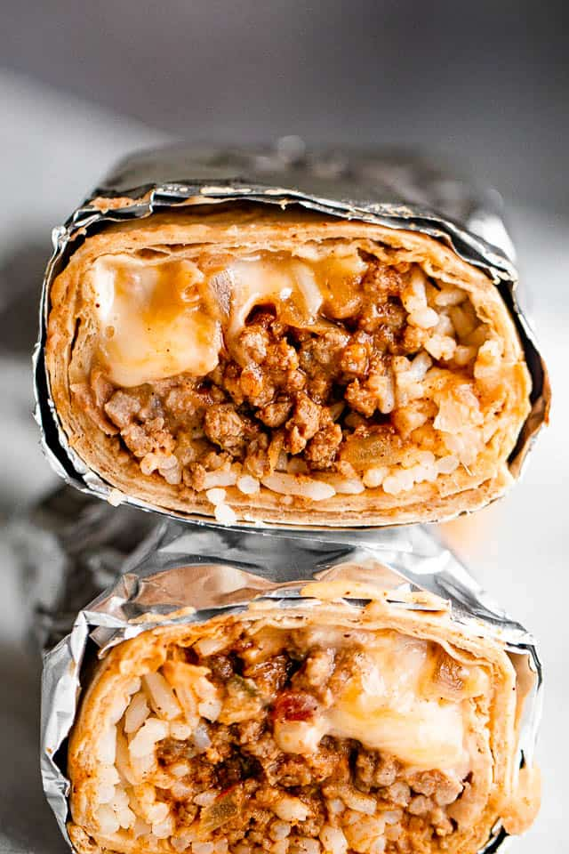 two burritos stacked one on top of the other
